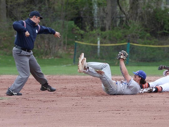 Umpire Ray Sarcone calls a runner out during a game between White Plains and Mahopac at White Plains High School April 24,  2017.