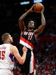Portland Trail Blazers center Ed Davis shoots as Los Angeles Clippers center Cole Aldrich defends during the second half in Game 2 of a first-round NBA basketball playoff series, Wednesday, April 20, 2016, in Los Angeles. The Clippers won 102-81. (AP Photo/Mark J. Terrill)