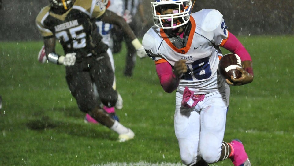 Millville's Clayton Scott (28) rushes against Absegami