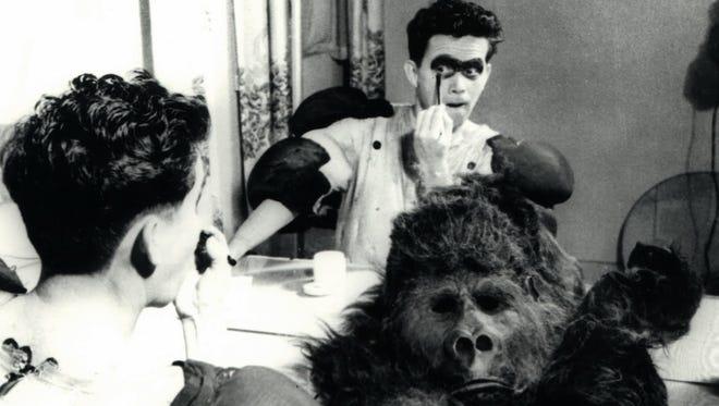 Publicity photos showing Charlie preparing to put on  his gorilla suit.