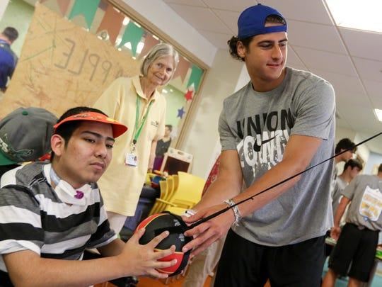 Michael Barletta, of New Providence High School, helps