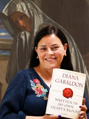 """Diana Gabaldon with her latest book """"Written In My Own Heart's Blood"""" at her home on May 14, 2014, in Paradise Valley."""