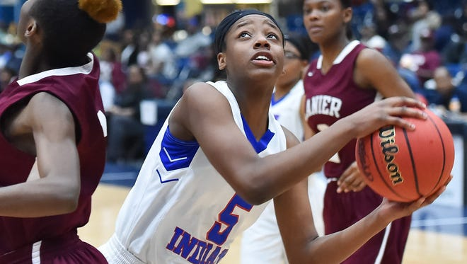 Byhalia's Tialexus Stevenson (5) looks to shoot against Lanier during the MHSAA Girls 4A Tournament held at Jackson State in Jackson MS