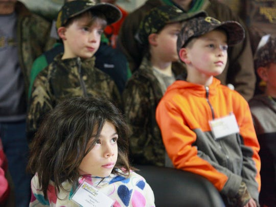 Miranda Ayers watches with other children  at the start the annual J.A.K.E.S. youth gun event with a prayer and a safety lesson from Lennie Tolley on Saturday at Shenandale Gun Club in Buffalo Gap.