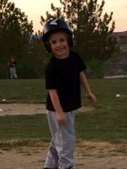 Mason Jensen prepares for his first tee ball game.