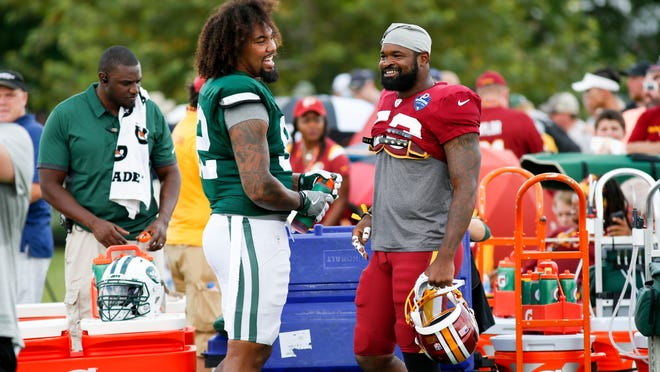 New York Jets Leonard Williams (92) and Washington Redskins Zach Brown (53) talk before NFL football training camp in Richmond, Va., Sunday, Aug. 12, 2018. (AP Photo/Parker Michels-Boyce)