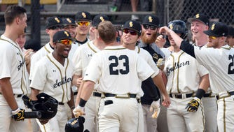 Southern Miss' Luke Reynolds celebrates with teammates after hitting a home run against Mississippi State Saturday at Pete Taylor Park.
