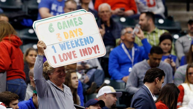 The 'Pacers Guy' Matt Asen holds up a sign during the first half in the first round of the 2017 NCAA Tournament between the Kentucky Wildcats and Northern Kentucky Norse at Bankers Life Fieldhouse.