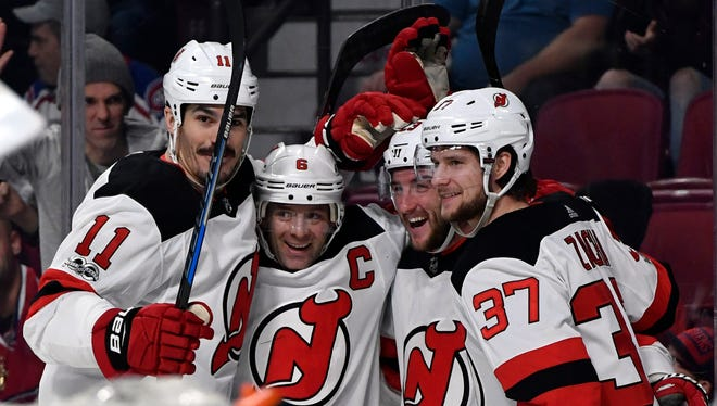 New Jersey Devils forward Stefan Noesen (23) reacts with teammates including Brian Boyle (11) and Andy Greene (6) and Pavel Zacha (37) after scoring a goal during the first period at the Bell Centre.
