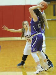Jim Ned's Jolie Branch (10) defends against a Wylie player. Wylie beat the Lady Indians 47-40 in the nondistrict game Monday, Dec. 19, 2016 at Bill Thornton Arena in Tuscola.