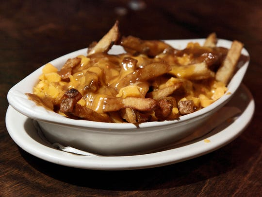 """Some attribute the name """"poutine"""" to the French-Canadian version of English """"pudding."""""""