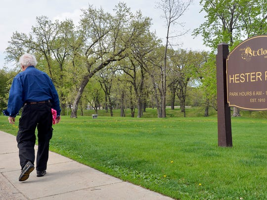 Dick Bernick walks along Sixth Avenue in Hester Park