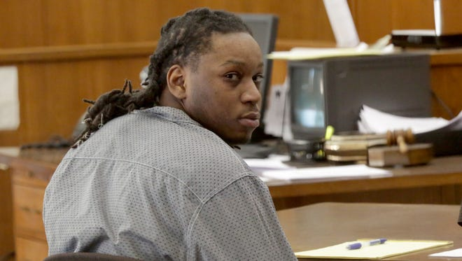 Antonio Smith's nephew, Shaheem Smith, looks to the gallery during their trial in February.