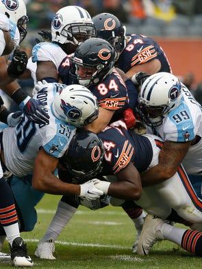 Chicago Bears running back Jordan Howard (24) is tackled