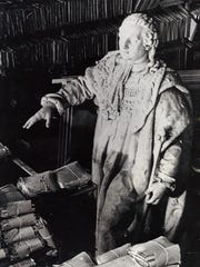 The marble likeness of King Louis XVI stands out of