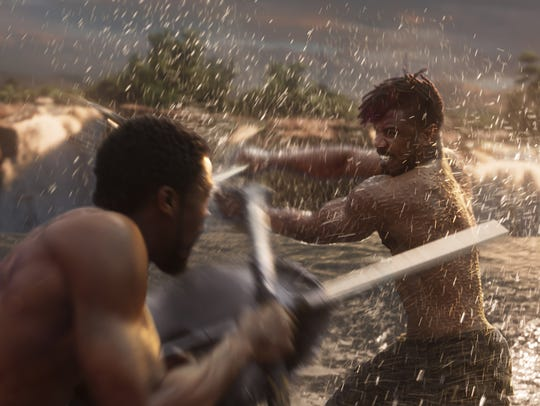 T'Challa (Chadwick Boseman, left) battles Erik Killmonger