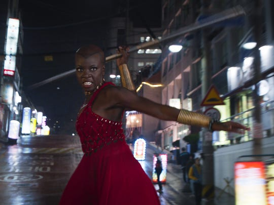 "Okoye (Danai Gurira) uses her deadly spear in the middle of a car chase in ""Black Panther."""