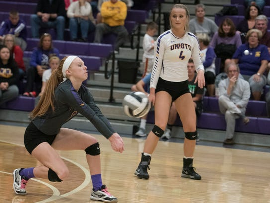 Unioto's Hallie Pinkerton receives a serve during a