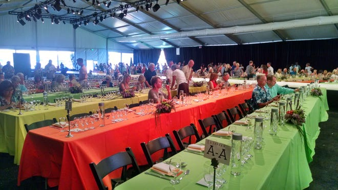 The citrus color scheme of the Food + Wine Festival luncheon on March 27 included tables dressed in tangerine, lemon and lime.