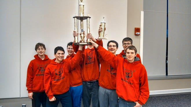Wildcats hoisting 2nd place trophy at the States
