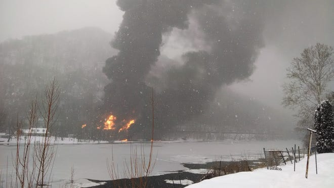 In this photo provided by WCHS-TV, fire burns at the scene of a Monday train derailment near Mount Carbon, W.Va. Fires burned for nearly nine hours after the train carrying more than 100 tankers of crude oil derailed in a snowstorm, plunging at least one tanker into a river while sending a fireball into the sky, authorities and residents say.