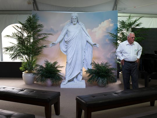 A statue of Jesus stands in the tour reception area at the 27,423-square-foot temple.