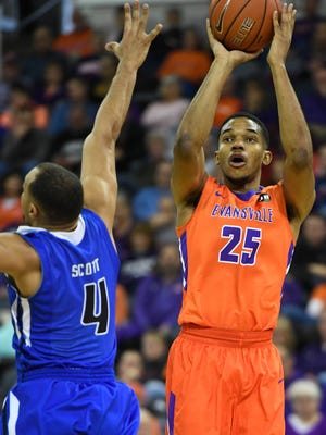 Evansville's Duane Gibson shoots over Indiana State's Brenton Scott as the University of Evansville hosts Indiana State at the Ford Center Saturday, February 25, 2017.