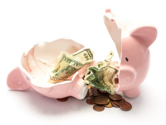 Piggy bank broken with money inside
