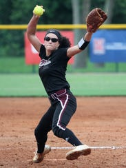 Madison County pitcher Reese Rutherford pitches during