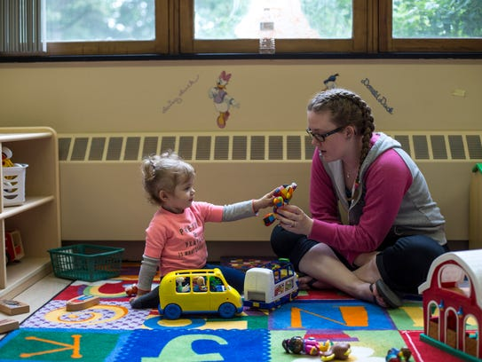 Zoey Biscarner, 22 months, plays with Rachel Jones,