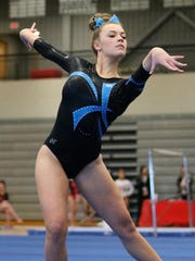 Regional all-around champion Aniessa Conway of Livonia Blue performs a floor exercise routine.