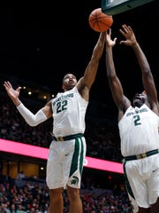 Michigan State's Miles Bridges, left, and Jaren Jackson Jr. reach for a rebound against Georgia during the first half of an NCAA college basketball exhibition game, Sunday, Oct. 29, 2017, in Grand Rapids.