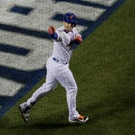 New York Mets' David Wright celebrates his two-run home run during the first inning of Game 3 of the Major League Baseball World Series against the Kansas City Royals Friday, Oct. 30, 2015, in New York. (AP Photo/Peter Morgan)
