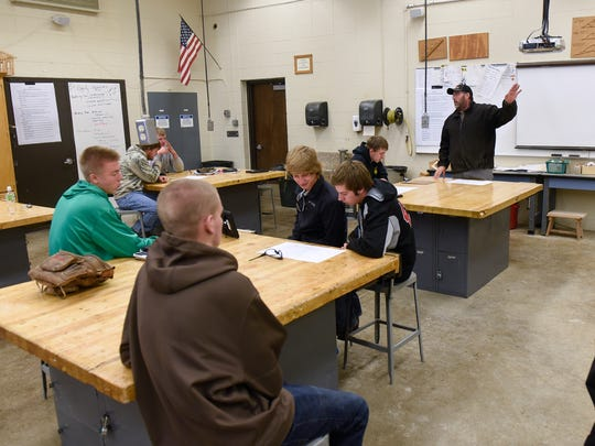 Tony Vesledahl talks to building trades class members at the beginning of a work session Wednesday, Oct. 26, at Milaca High School.