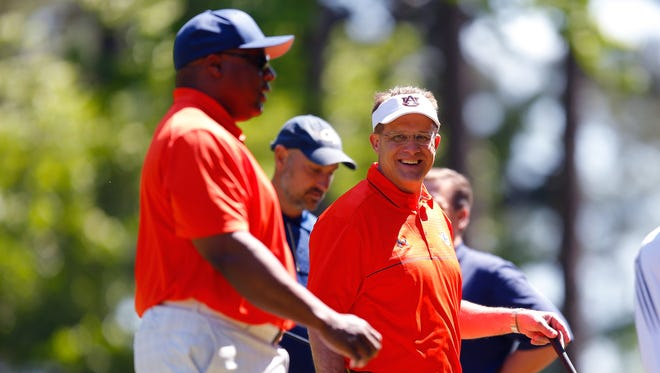 AuburnÕs Bo Jackson and Gus Malzahn smile during the 2015 Chick-fil-A Peach Bowl Challenge Round on the Oconee Course at Reynolds Plantation on Tuesday, April 28, 2015. (Chick-fil-A Peach Bowl/Abell Images/Paul Abell)