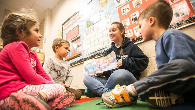 York Tech senior Samantha Flickinger, center, reads 1-2-3 Va-Va-Vroom! to York Tech/LIU preschoolers Alyssa Monusov, left, 4, Perry Jones, 4, and Logan Mendenhall, right, 5, Tuesday, April 4, 2017, at York County School of Technology. Flickinger, along with two other students Summer Schanberger and Cassandra Shermeyer, won a Gold medal at the FCCLA (Family, Career and Community Leaders of America), for advocating a change in regulation to allow volunteers from approved technical programs to work in a licensed childcare facility under the age of 16. Amanda J. Cain photo