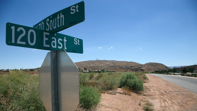 A street sign marks the corner of 120 East and 1670 South streets in St. George.