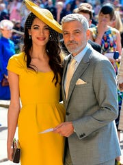 Amal Clooney and George Clooney arrive for the wedding
