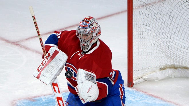 Montreal Canadiens goalie Carey Price (31) makes a save against against the Chicago Blackhawks during the third period at the Bell Centre.