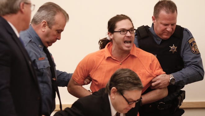 Dylan Lentini is physically led out of the courtroom by officers on Tuesday, Nov. 29, 2016, after becoming disruptive before sentencing in state Supreme Court for stabbing to death retired teacher Michael Wimbert.