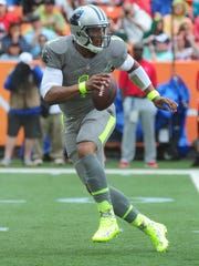 Cam Newton #1 of the Carolina Panthers and Team Sanders scrambles against the Team Rice during the 2014 Pro Bowl.
