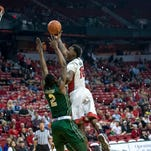 UNLV Rebels forward Dwayne Morgan (15) lays up the ball over Colorado State Rams forward Emmanuel Omogbo (2) during the first half at Thomas & Mack Center.