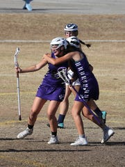 Cypress Lake's (23) Laura MacDiarmid gets a hug after one of her many goals against Estero.
