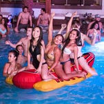 The hot dog carries an inflatable boat load of ladies at Maya Day + Nightclub on Monday, Aug. 18, 2014.
