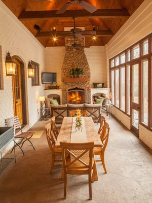 Vaulted ceilings, brick walls and scored concrete create a rustic look.