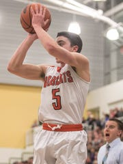 Northeastern's Antonio Rizzuto (5), goes up for a shot,