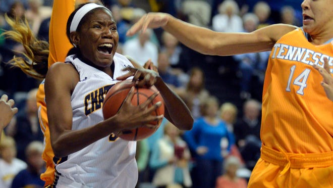 Tennessee Chattanooga Lady Mocs center Jasmine Joyner (3) rebounds against Tennessee's Andraya Carter (14) in the first half of an NCAA college basketball game Wednesday, Nov. 26, 2014, in Chattanooga, Tenn. (AP Photo/Billy Weeks)