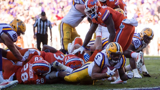 LSU running back Derrius Guice (5) is stopped short of the goal line on third down against Florida during the second half of their game Nov. 19, 2016.