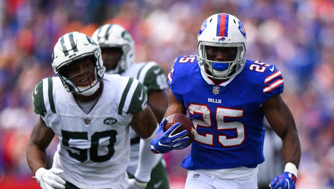 Buffalo Bills running back LeSean McCoy (25) runs with the ball in front of New York Jets inside linebacker Darron Lee (58) during the second quarter at New Era Field.