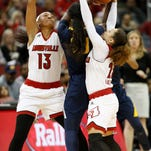 Louisville's Briahanna Jackson, right and Cortnee Walton trapped a California player in the backcourt in the second half. Nov. 16, 2015.